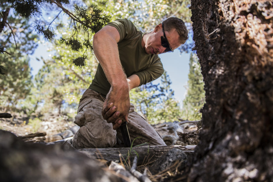U.S. Marine Cpl. Matthew Newman cuts wood to make a survival shelter during Mountain Exercise 2014 aboard Marine Corps Mountain Warfare Training Center in Bridgeport, Calif., Aug. 28, 2014. Newman is team leader with 2nd Platoon, India Company, 3rd Battalion, 1st Marine Regiment. Marines with 3rd Battalion, 1st Marine Regiment will become the 15th Marine Expeditionary Unit's ground combat element in October. Mountain Exercise 2014 develops critical skills the battalion will need during deployment. (U.S. Marine Corps photo by Sgt. Emmanuel Ramos/Released)